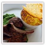 Pan seared lamb chops with pea puree, ricotta cheese souffle and parmesan chip